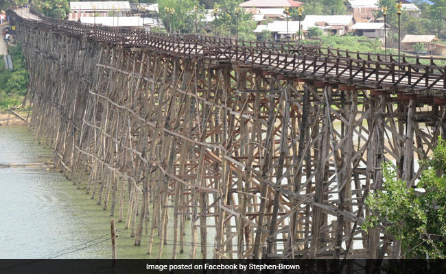 Image result for Thailand's Longest Wooden Bridge May Collapse As Heavy Rain Continues