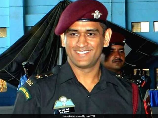 A Picture Of MS Dhoni Signing A Cricket Bat In Army Uniform Has Gone Viral