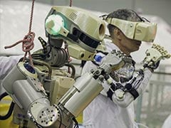 Soyuz Spacecraft Carrying Humanoid Robot Docks At Space Station