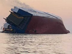 Trapped Crew Members Rescued From Overturned Cargo Ship, Coast Guard Says