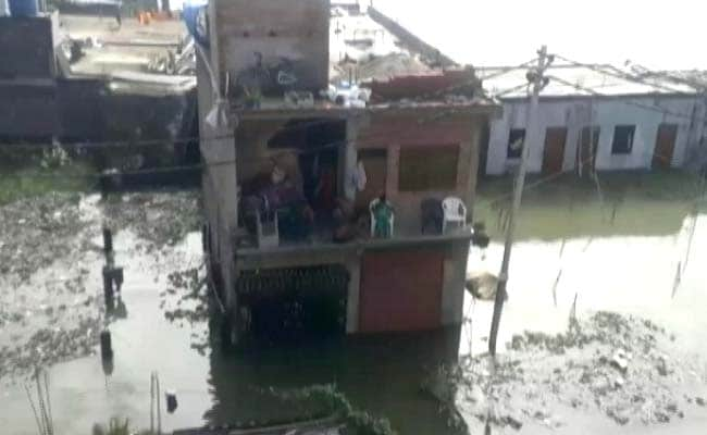 Rain In UP's Prayagraj Partially Submerges Houses, People Take Shelter On Rooftop