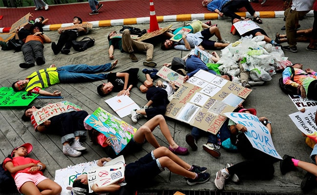 More Than 200 Young Climate Strikers 'Drop Dead' At Thai Ministry