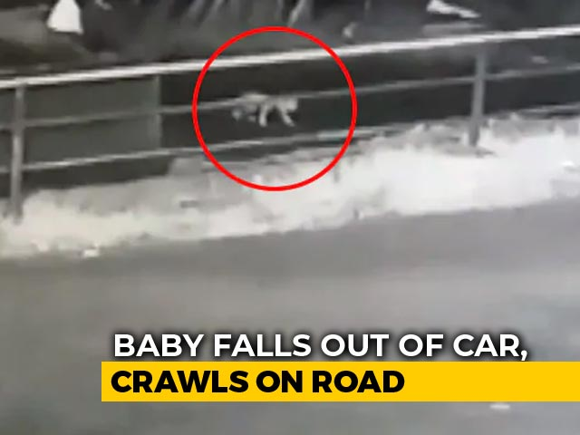 Video : Watch: Baby Crawls On Kerala Road After Falling Off SUV As Parents Doze Off