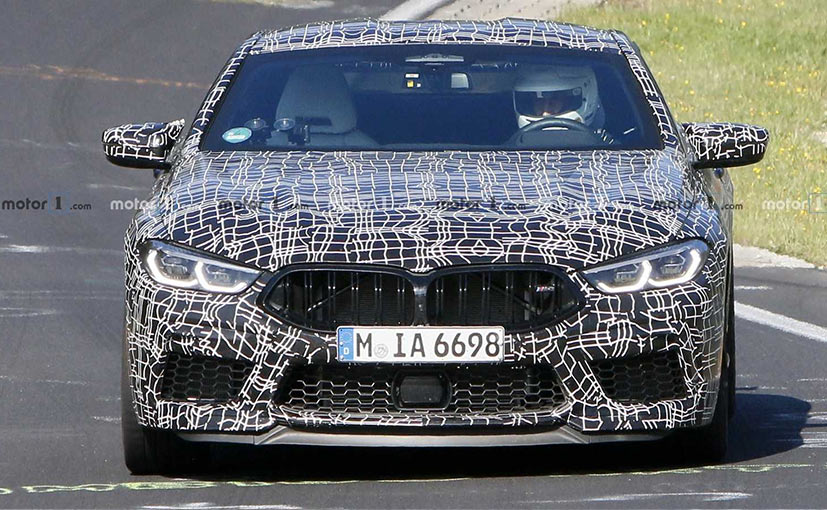 The BMW M8 has a hunkered down front and gets black kidney grille.
