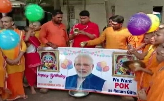 Workers Of NDA Ally Pour Milk On PM's Photo, Want PoK As Return Gift