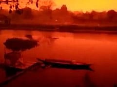 """This Is Earth Not Mars"": Blood Red Skies Unsettle Indonesians"
