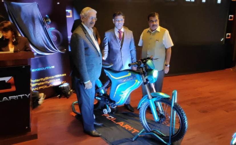 Sachin Jadhav, CMD, Polarity Smart Bikes and Union Minister Nitin Gadkari with the new electric bike
