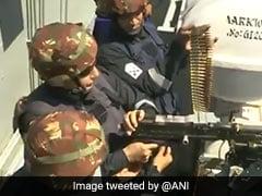 Watch: Rajnath Singh Fires Machine Gun From Navy's Aircraft Carrier