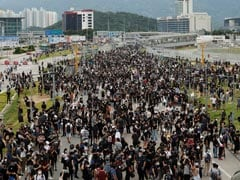 After Night Of Chaos, Hong Kong Protesters Target Airport, Block Roads