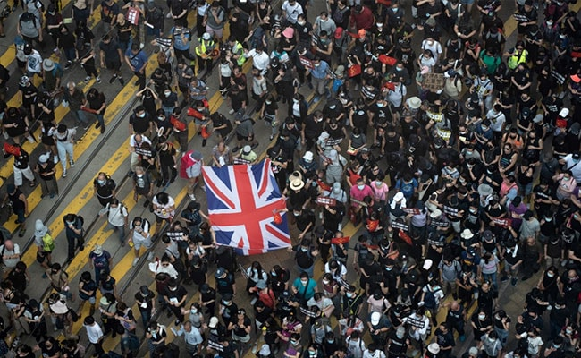 Police Shoot Hong Kong Protester In Chest During Clashes