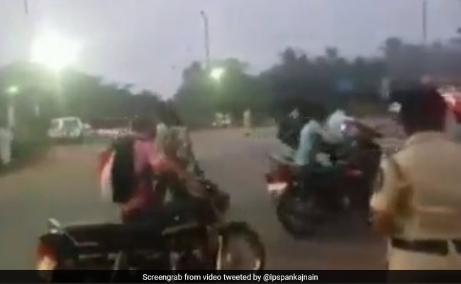Watch: To Avoid Fines For No Helmets, Riders Walk Past Cops With Vehicles