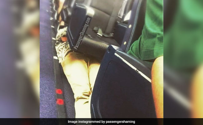Visionary Or Vile? Pic Of Passenger Lying Under Airplane Seats Is Viral
