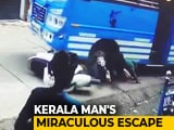 Video : Watch: Man Escapes Unhurt After Bus Hits, Drags Him On Kerala Road