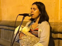 She Sings On A Street In Peru, Rocking Her Baby In Her Arms. It's OK To Cry