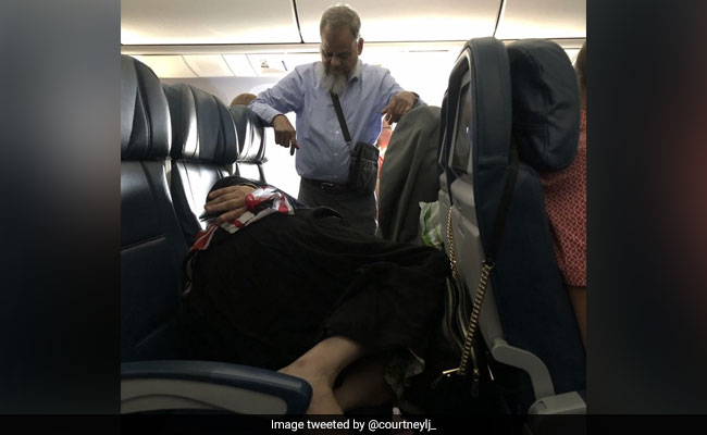 Man Stood For 6 Hours In Flight To Let Wife Sleep. Twitter Divided