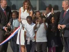 Watch: Melania Trump, With Large Scissors, Struggles To Cut Ribbon