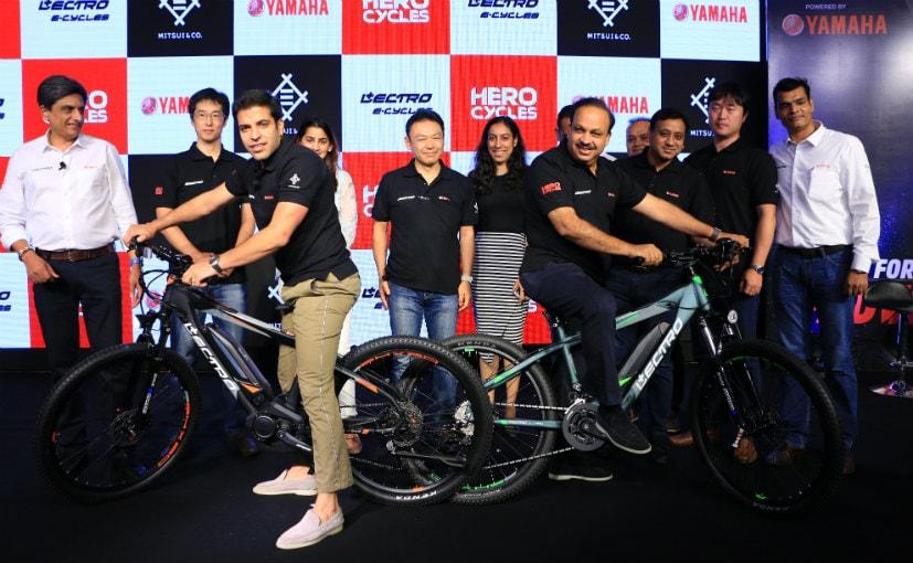 Aditya Munjal and Pankaj Munjal at the launch of the Lectro EHX20 electric bike
