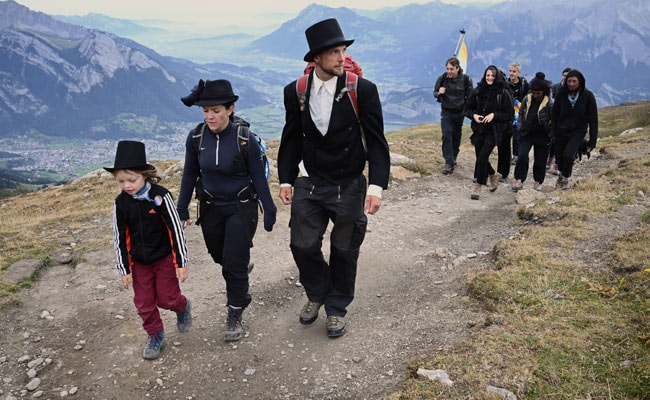 Vanishing Swiss glacier gets its own funeral procession