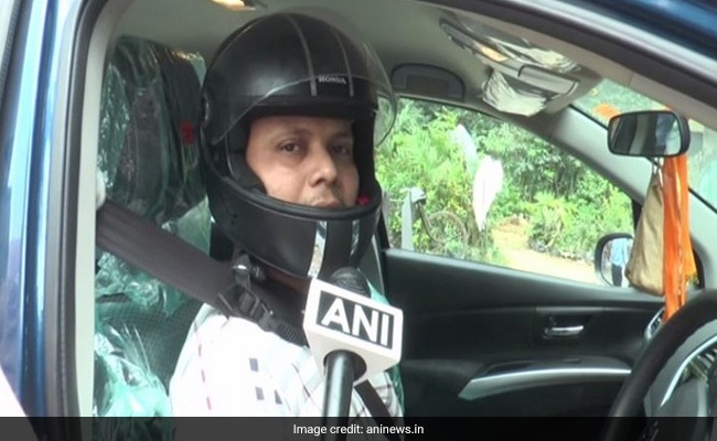 Why An Aligarh Man Has Started Wearing A Helmet While Driving Car