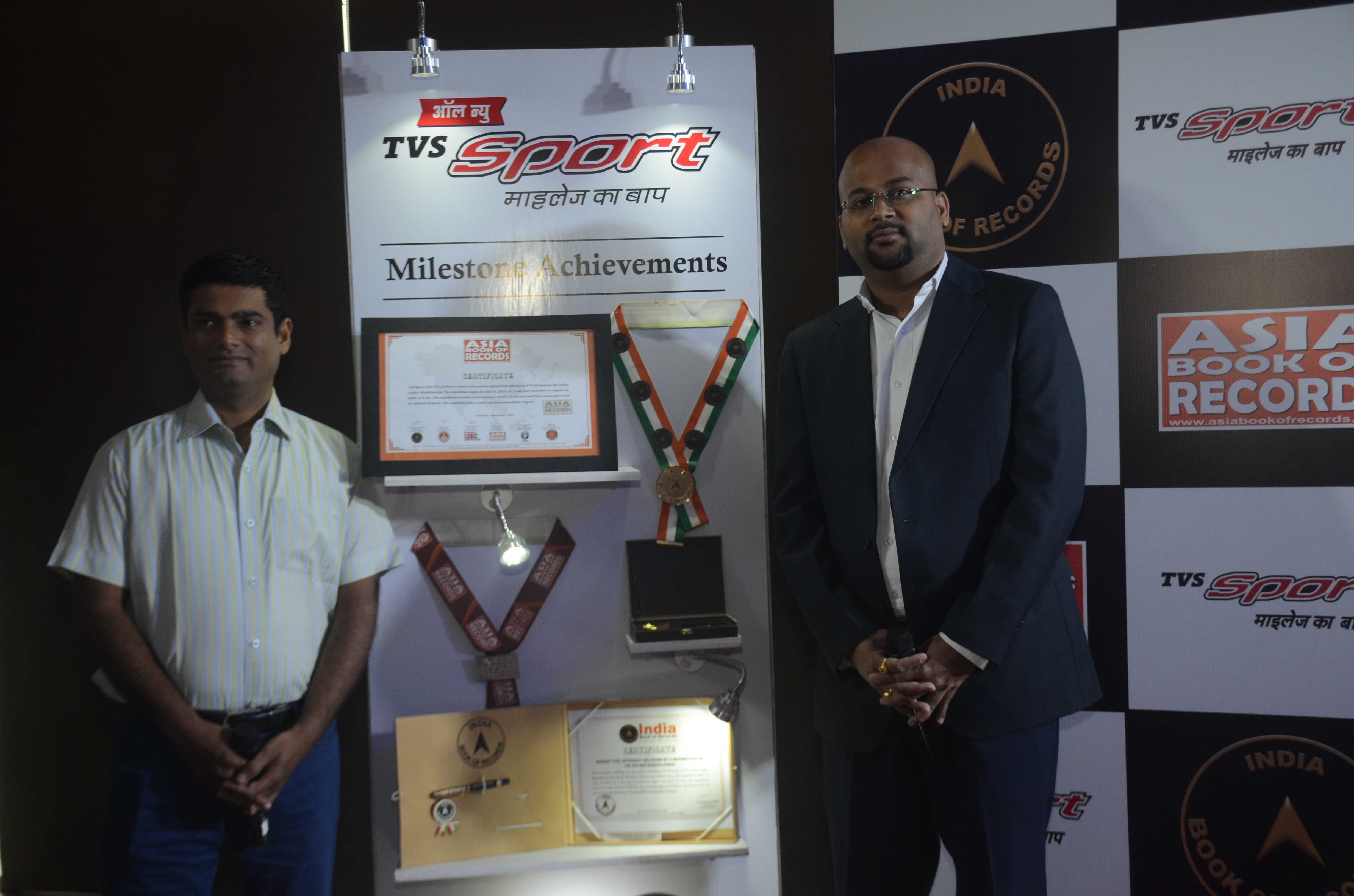 Piyush Singh, Head (Marketing), Commuter Motorcycles, with TVS Sport rider Pavitra Patro