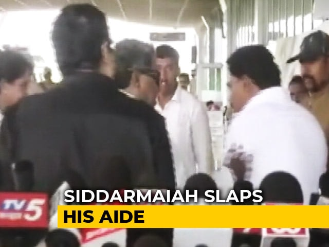 Video : Congress's Siddaramaiah Caught On Camera Slapping Aide At Mysuru Airport