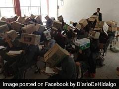 Cheating रोकने के लिए टीचर ने स्टूडेंट्स के सिर पर रख दिया डिब्बा, वायरल हुई फोटो