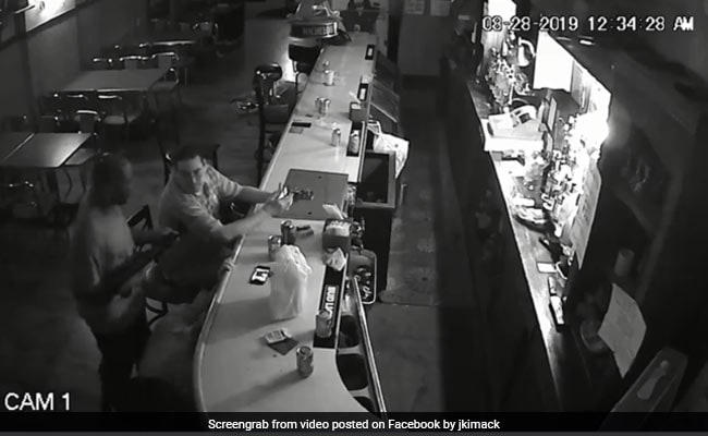Man Refuses To Give Up Phone, Smokes Calmly During Armed Robbery. Watch