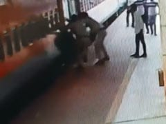 Man Slips Trying To Board Moving Train. Watch Incredible Rescue By RPF
