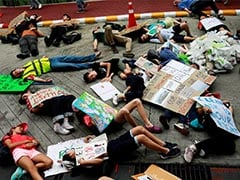 "More Than 200 Young Climate Strikers ""Drop Dead"" At Thai Ministry"