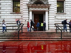 "1,800 Litres Of ""Fake Blood"" Sprayed On UK Treasury By Climate Activists"