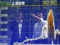 Asian Shares Hold Near 18-Month Highs, Up Over 1% So Far This Week
