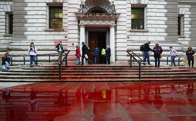 1,800 Litres Of 'Fake Blood' Sprayed On UK Treasury By Climate Activists