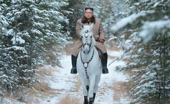 Kim rides white horse on sacred mountain, vows to fight US sanctions