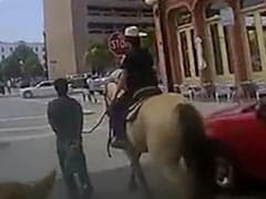 """""""Stay Next To Me"""": US Cop, On Horseback, Leads Black Man Tied To Rope"""