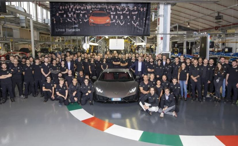 Lamborghini employees with the milestone 14,022th car, a Lamborghini Huracan EVO Coupe
