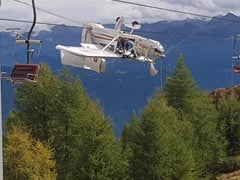 Plane Dangles Upside-Down From Ski Lift Cables After Crash