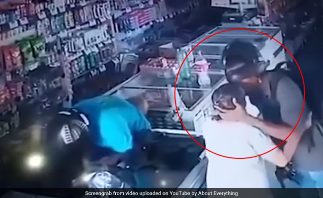 Watch: Armed Robber Refuses Cash From Elderly Woman, Kisses Her Forehead