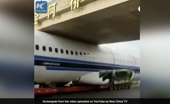 Viral: Airplane Gets Stuck Under Bridge In Bizarre Video