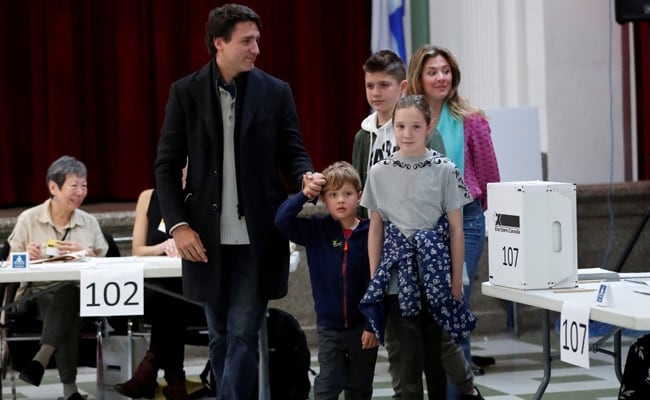 Justin Trudeau's Party Takes Early Lead As First Polls Close In Canada