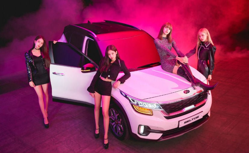 K-Pop girl band BLACKPINK with the Kia Seltos compact SUV