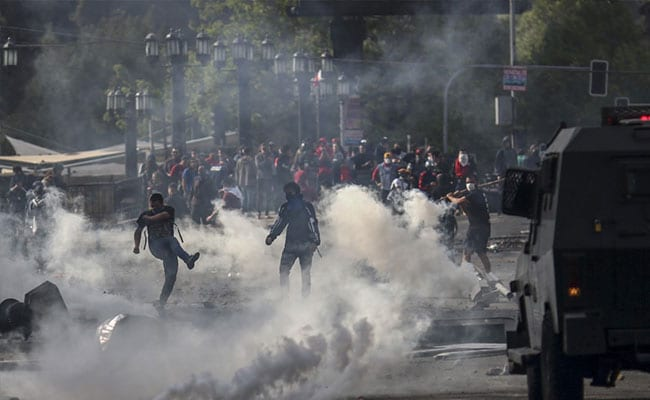 Chile's president reverses fare increase as unrest continues
