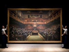 Banksy's UK Parliament Painting Sells For $12.1 Million At Auction