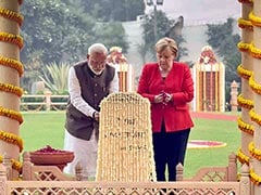 PM Modi, Angela Merkel Pay Homage To Mahatma Gandhi At Gandhi Smriti