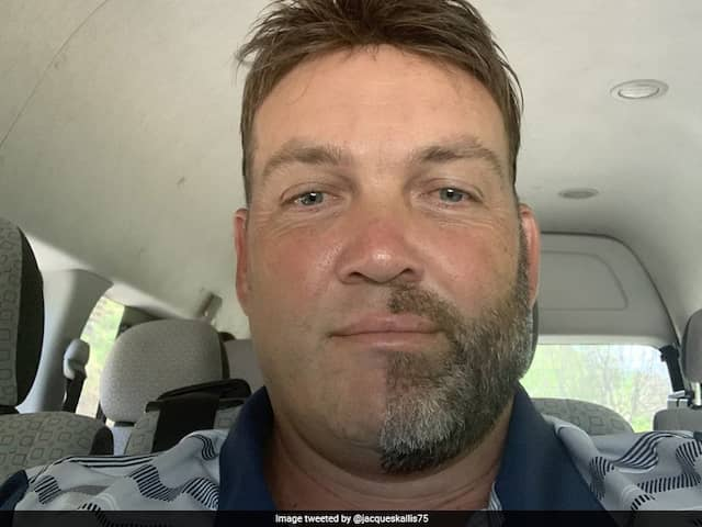 Jacques Kallis shaves off exactly half his beard for a noble cause