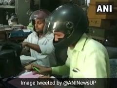 यूपी सरकार के कर्मचारी हेलमेट लगाकर कर रहे हैं दफ्तर में काम, सामने आई चौकाने वाली वजह
