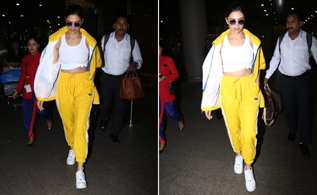 Deepika Padukone snapped at the airport in a bright yellow outfit
