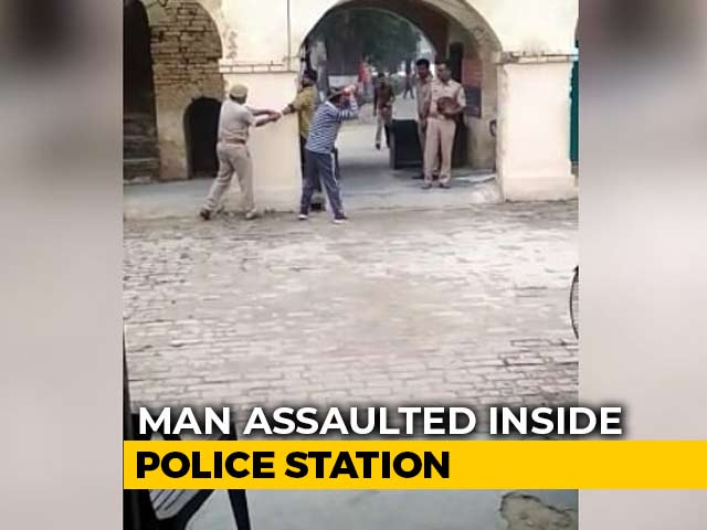 Video : On Camera, UP Cops Pin Man, Thrash Him With Belt For Eloping