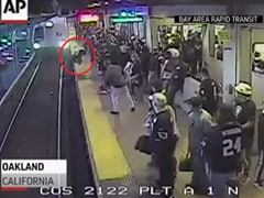 Man Pulled From Tracks Seconds Before Train Arrives In Dramatic Video