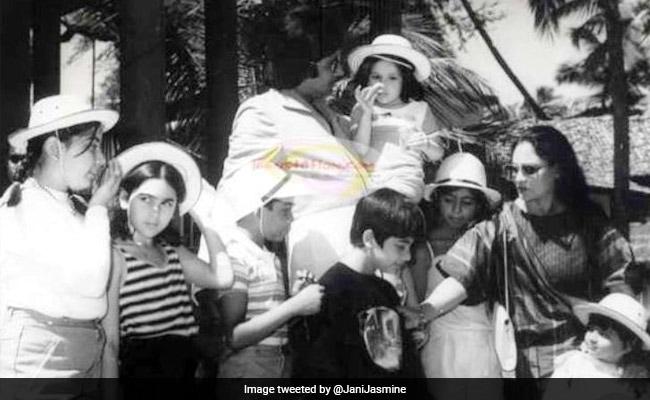 अमिताभ बच्चन की गोद में नजर आई यह बच्ची, जो है आज की सुपरस्टार, पहचानें कौन?