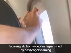 Two Grown Men Fight Over An Airplane Window Shade In This Viral Video